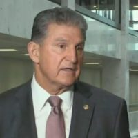 Joe Manchin speaks to reporters about the debt limit
